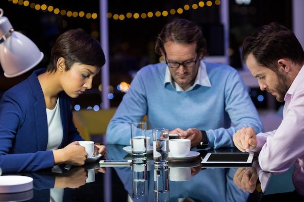 Business people taking tea break