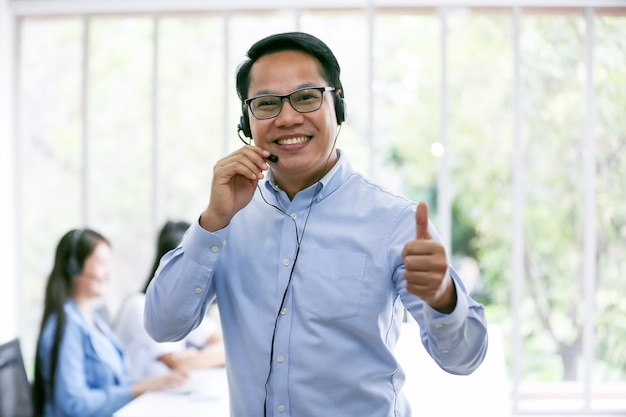 Business people talking on telephone with headset at office for customer help service concept
