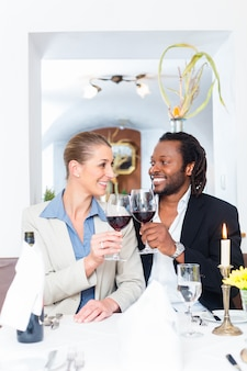 Business people toasting on deal with wine