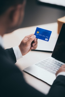 Business people use credit cards to do financial transactions at work