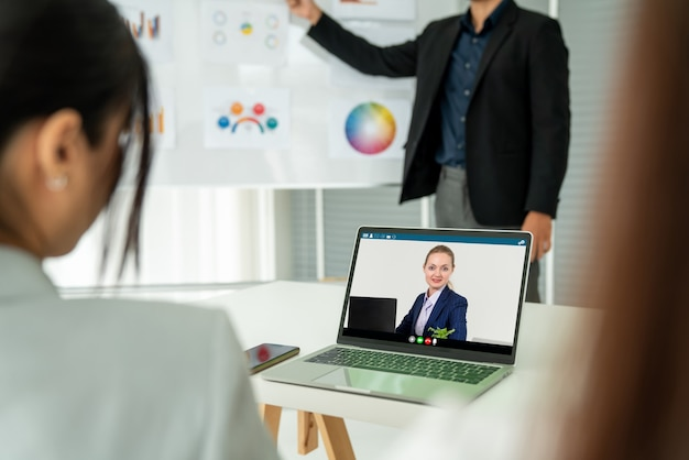 Business people in video call meeting proficiently discuss business plan