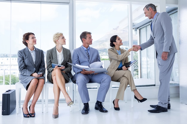 Business people waiting to be called into interview