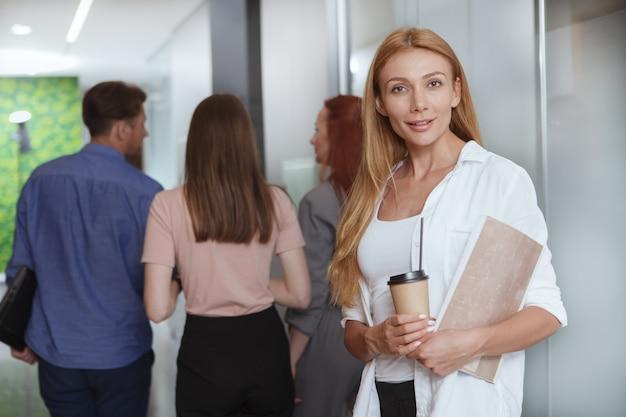 Business people walking along the hallway