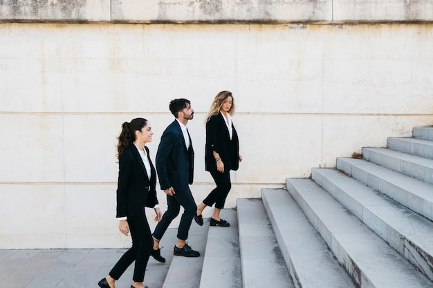 Business people walking upstairs Free Photo