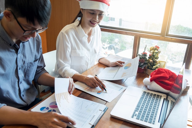 Business people wearing santa hat  celebrating 2019 new year christmas presents at office