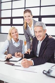 Business people with client in meeting room