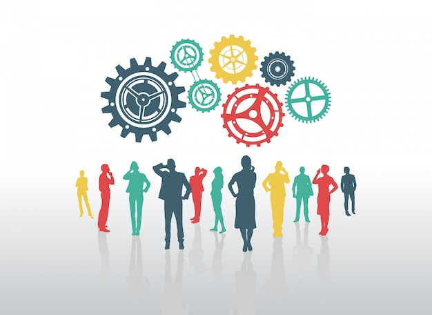Business people with cogs and wheels