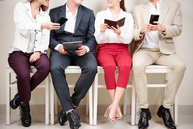 Business people with gadgets
