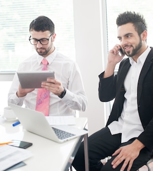 Business people with tablet working in office