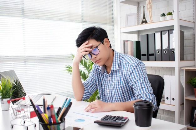 Business people work hard using serious work stress business working concepts, office syndrome