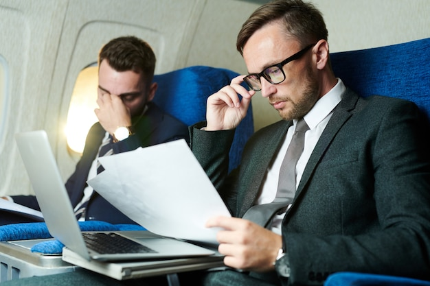 Business people working in airplane