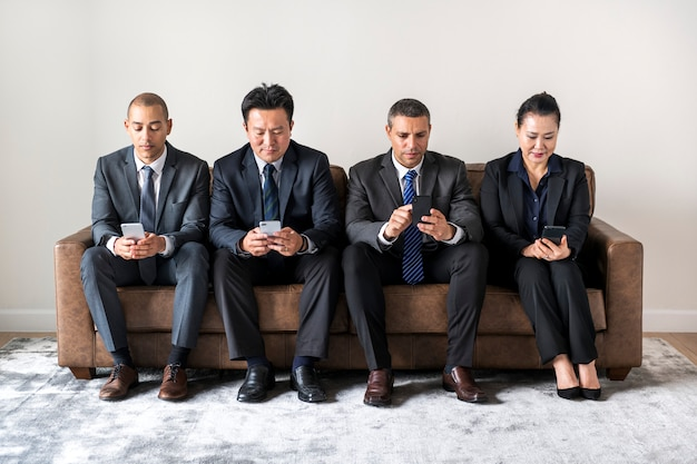 Business people working on gadgets