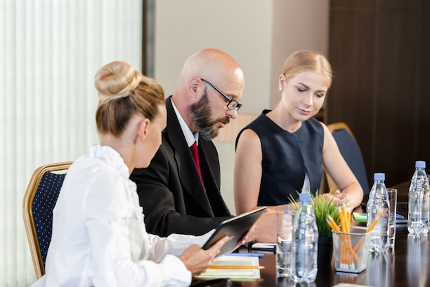 Business people working together at conference table