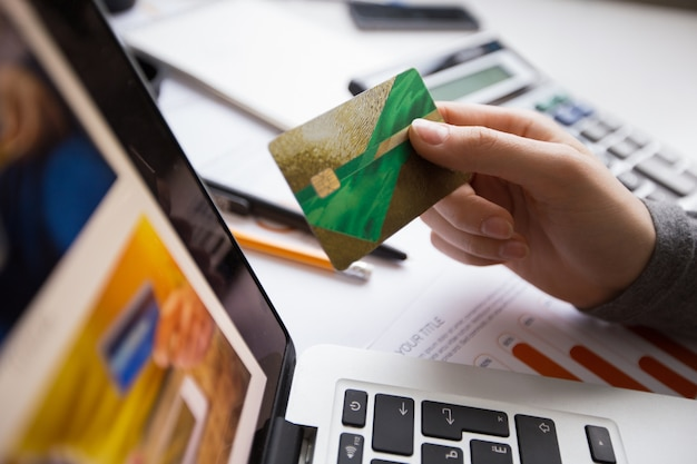 Business person hand holding credit card