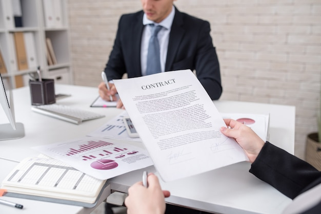 Business person reading contract