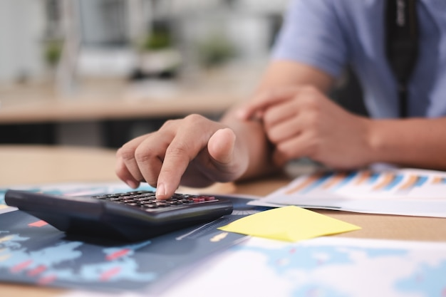 Business pointat calculator about tax and profit/loss account with report document