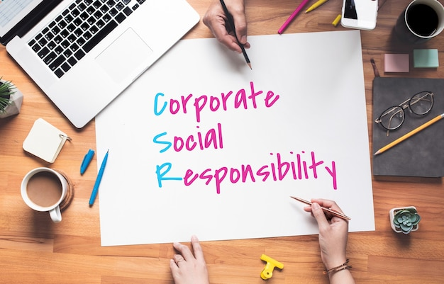 Business policy with corporate,social,responsibility text on desk office