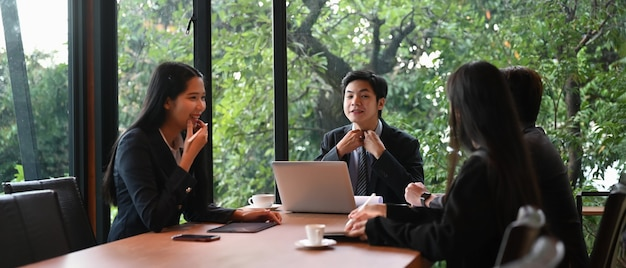 Business professionals working together in meeting room at office.