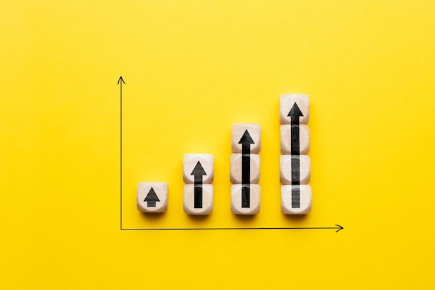 Business profit growth concept with arrows on graph.