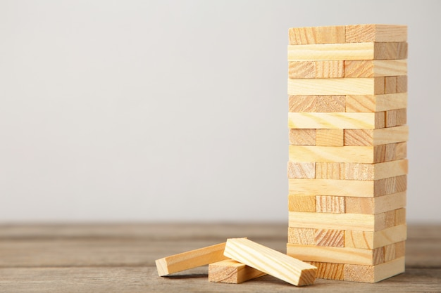 Business risk concept with wooden game. top view