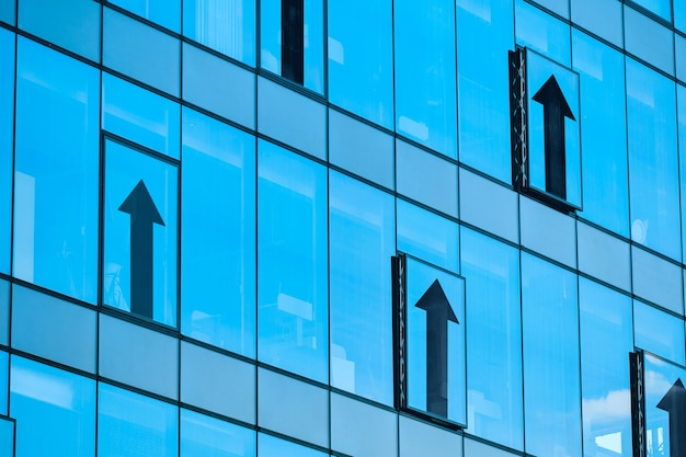 Business sales growth concept with abstract arrows on building