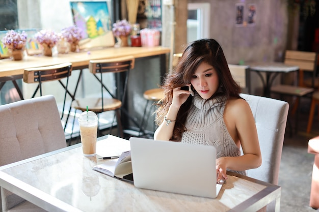 Business selling online, young asian woman in casual dress working