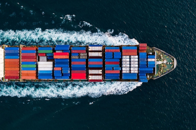 Business service transportation of international by container cargo freight ship open in deep sea aerial view