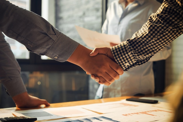 Business shaking hands people agreement of success concept.