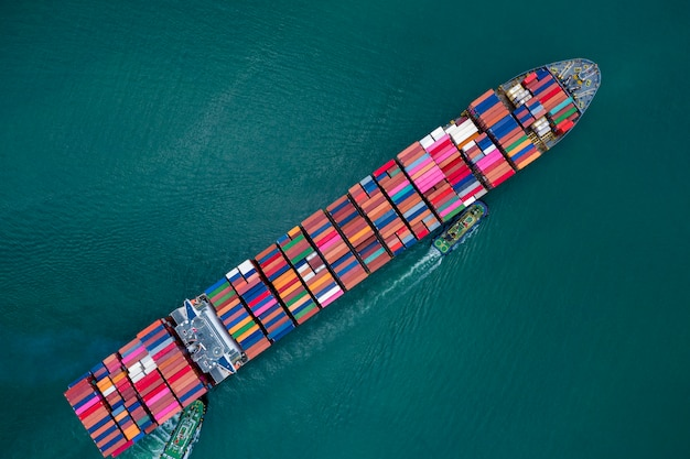 Business and shipping cargo containers by special large shipping vessels service industry transportation import and export international products open sea aerial view