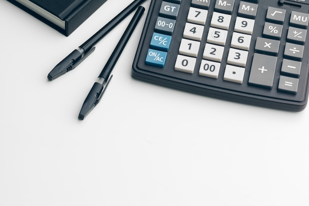 Business still life with calculator on table in office.