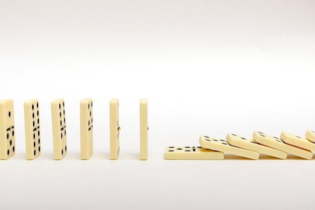 Business strategy concept. the domino effect stopped by a unique, one strong piece.