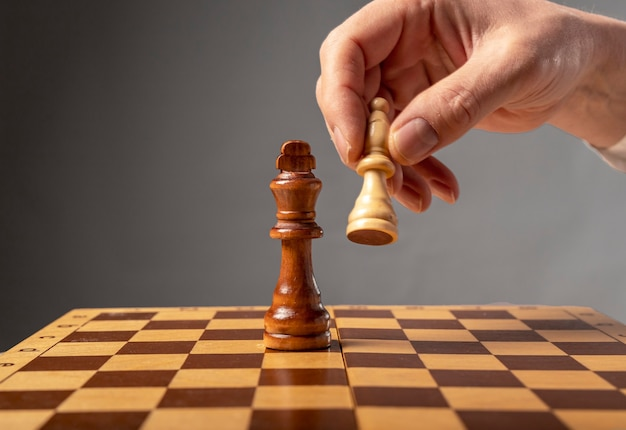 Business strategy concept. knight making final last step to make checkmate in chess, falling king.