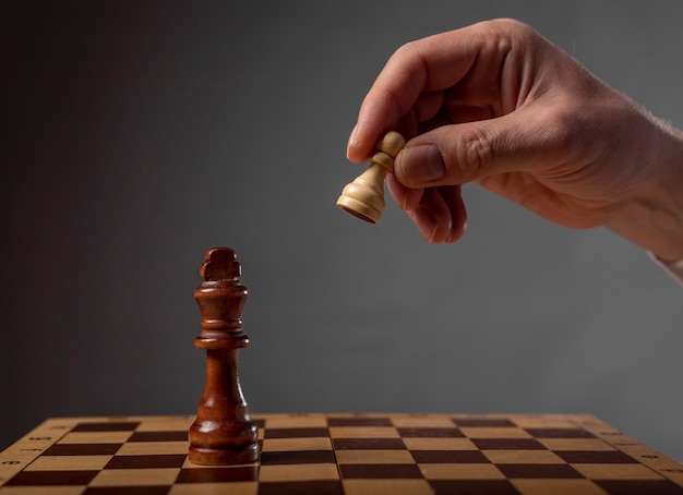 Business strategy concept. pawn making final last step to make checkmate in chess.