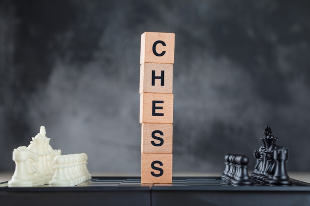 Business strategy concept with chessboard and figures, wooden cubes