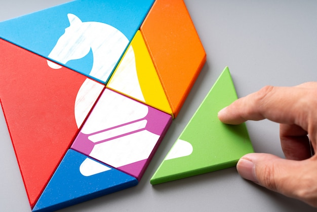Business and strategy icon on colorful puzzle