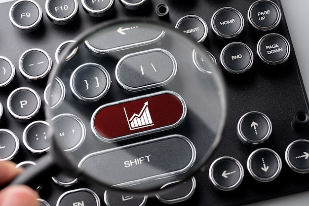 Business & strategy icon on computer keyboard in retro style