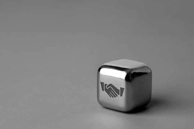 Business & strategy icon on metal cube for futuristic style