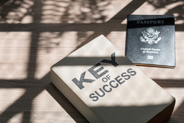 Business of success book and passport near window in the morning.