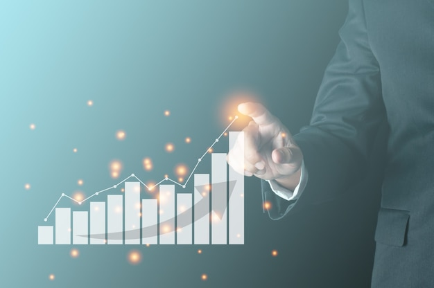 仮想棒グラフで成長線を指すビジネス成功の概念ビジネスパーソンは、会社の利益と収益の成長を示しています
