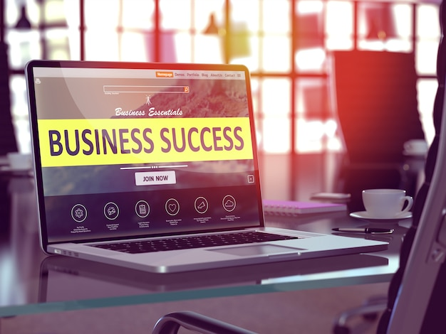 Business success concept. closeup landing page on laptop screen on background of comfortable working place in modern office. blurred, toned image.