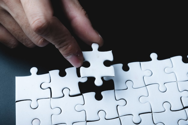 Business success concept idea of jigsaw puzzle, teamwork solution and join connection, strategy team together, match with cooperation partnership challenge