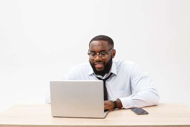 Business and success. handsome successful african american man wearing formal suit, using laptop computer for distant work