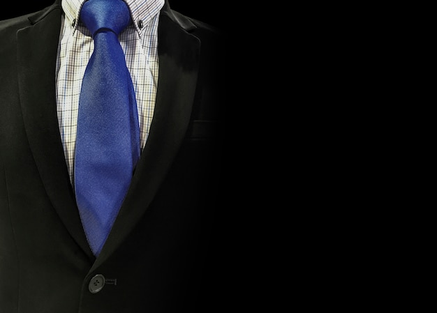 Business suit on black background with copy space