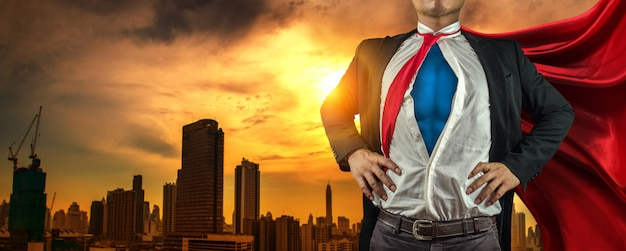 Business superhero man on the city