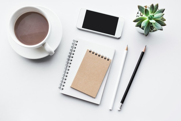 Business table top with mock up office supplies on white background