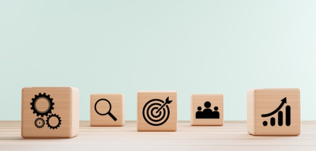 3dレンダリングによるビジネス達成目標ターゲットコンセプトのためのグラフメカニカルギアと人々の間の木製キューブブロック上のビジネスターゲットボードの印刷画面。