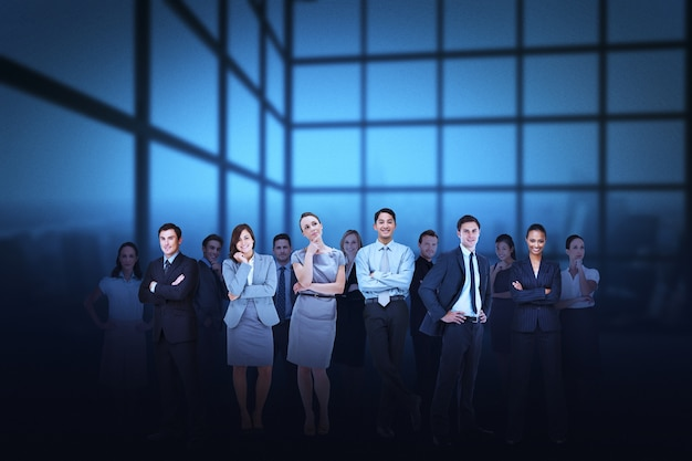 Business team against blue grid background