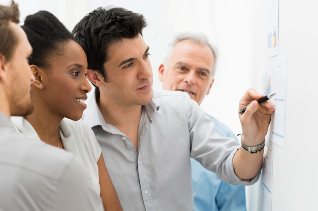 Business team analyzing graph