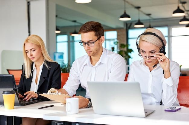 Business team concentrated on work on laptop