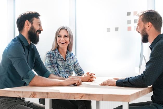 Business team discussing current tasks at the desktop. teamwork